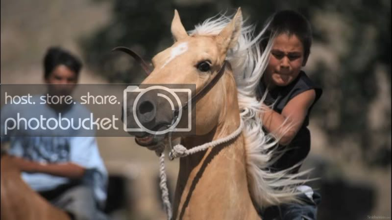 Young Lakota Rider on Palomino