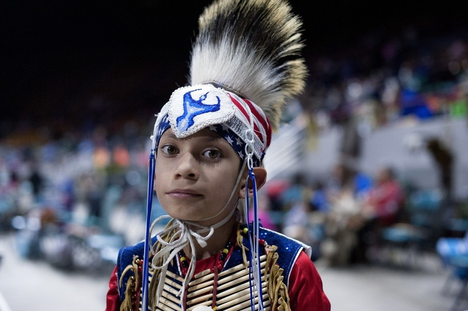 David Cyrus, 8, of the Crow Nation poses for a portrait prior to the Grand Entry during the Denver March Powwow on March 24, 2017 in Denver, Colorado. .Held over four days, the Denver March Powwow attracts an estimated 55,000 participants, made up of dancers, drummers, vendors, and spectators. Since 2009 roughly 95 nations, 35 US states, and five Canadian provinces have been represented during the powwow. / AFP PHOTO / Jason Connolly (Photo credit should read JASON CONNOLLY/AFP/Getty Images)