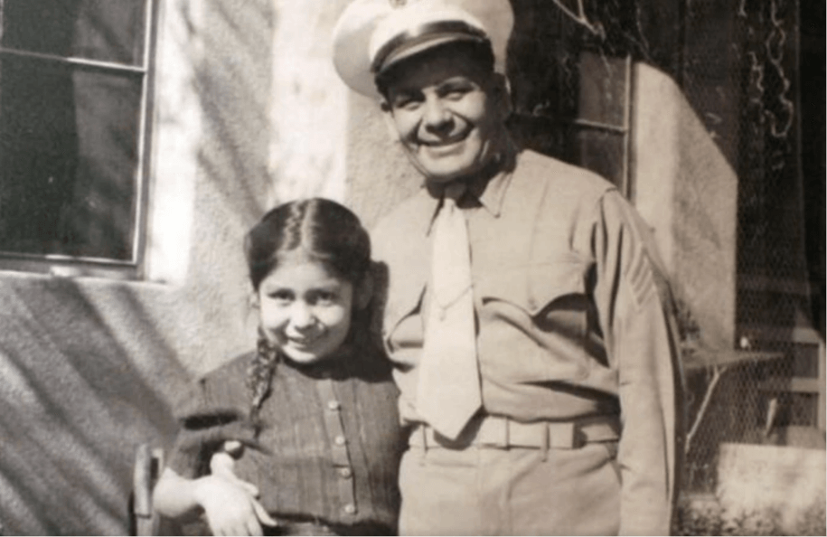 This image shows a photograph of Miguel Trujillo of Isleta Pueblo and his daughter that is on display as part of an exhibit at the Indian Pueblo Cultural Center in Albuquerque, New Mexico. Trujillo fought in 1948 for the right of American Indians to vote in New Mexico.