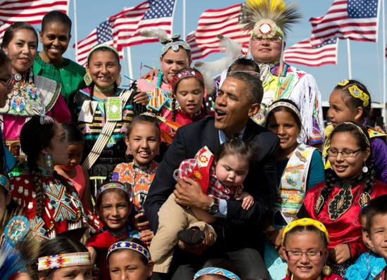 President Barack Obama and First Lady Michelle Obama attend the Cannon Ball Flag Day Powwow in Cannon Ball, North Dakota, June 13, 2014..(Official White House Photo by Pete Souza)..